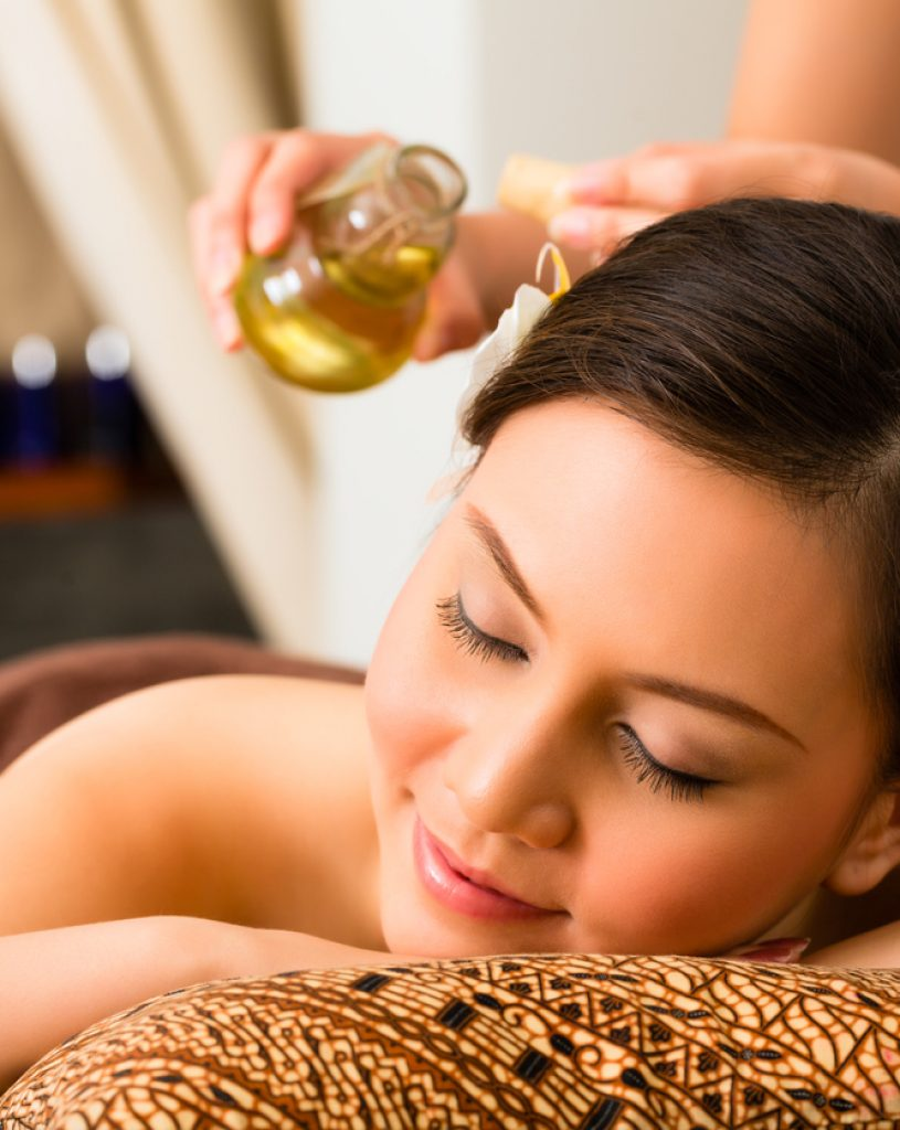 Woman at wellness massage with essential oils